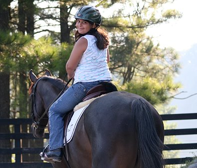 Happiness is learning to ride on an off-the-track Thoroughbred!