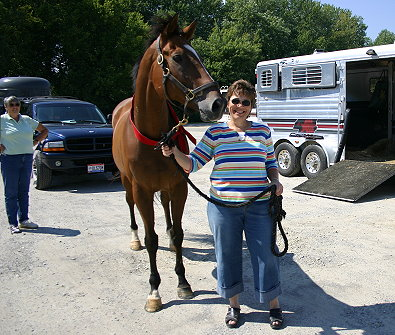 Daring Deeds with his new mom Carol Quinter and trainer Cherie looking on. - September 7, 2005