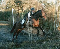 Fred E. (French Made) and mom Stephanie at a x-country clinic.