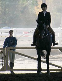 Megan Brown on Irish Morning Mist with her groom Marie van Roekel looking on. November 12, 2005