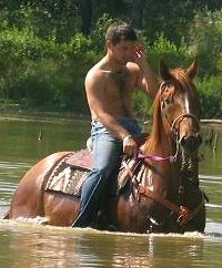 OTTB swims in lake with Amanda's friend Cody.