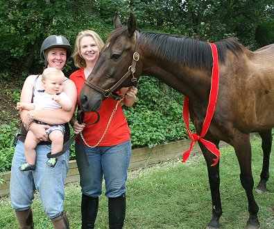 Trainer Karen Boysen with her son Adam, Mamie Kerr and Queen's Rowdy Lad.