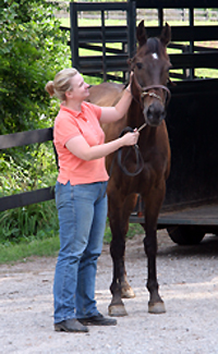 Mamie Kerr welcomes Queen's Rowdy Lad home to Bit & Byes Farm.. July 12, 2007