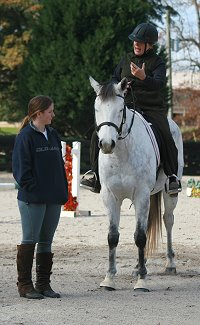 Vera Vogt demonstrates to Amy dressage concepts to apply.