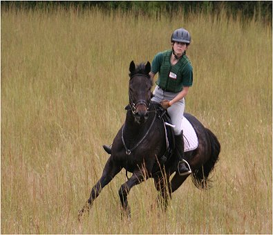 Marie van Roekel and Two Thumbs up enjoy a gallop at the poker ride. October 8, 2005