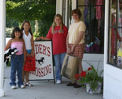 "Nieces Sabrina, Danielle and Katie with Aunt Elizabeth shopping for horse ""stuff""."