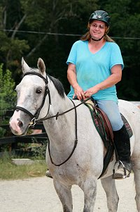 Kelly Fortner's first ride on her new ex-race horse, Cobb County. - August 24, 2007