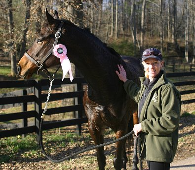 "K O River Crossing took home a pink ribbon at his first ""field trip"" off-the-farm."