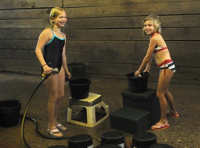 Kristen and her friend clean out feed buckets at Bits & Bytes Farm. July 12, 2008