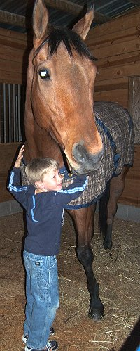 Jake hugs OTTB Phil's Courage.