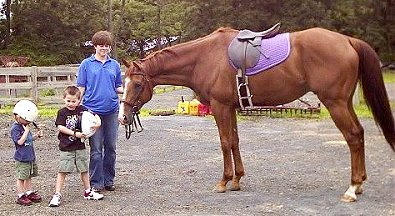 "Dr. Kenny Winn has become a ""family"" horse with husband Adam and sons Noah and Josh all riding this OTTB."