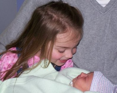 Grace welcomes her new little brother.