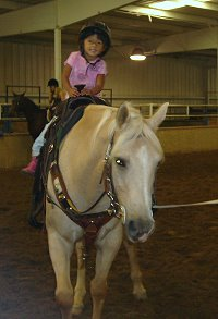 Paula's daughter Elizabeth enjoys riding too!