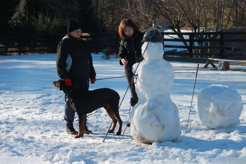 Suellen and Andi stack a snow woman