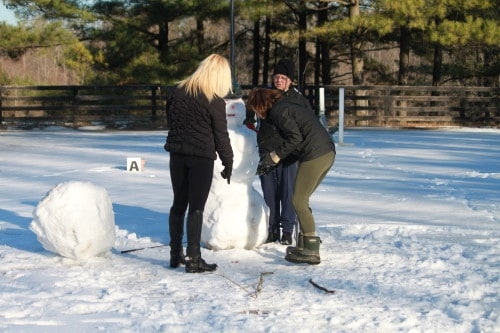 Loui adds a little more definition to the snow woman