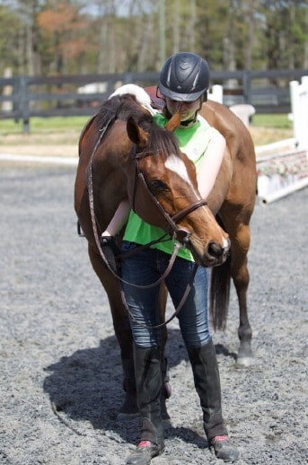 OTTB Maybe Satisfied and his current owner.